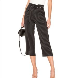 About Us: Chloe Pleated Pant in Black Pinstripe